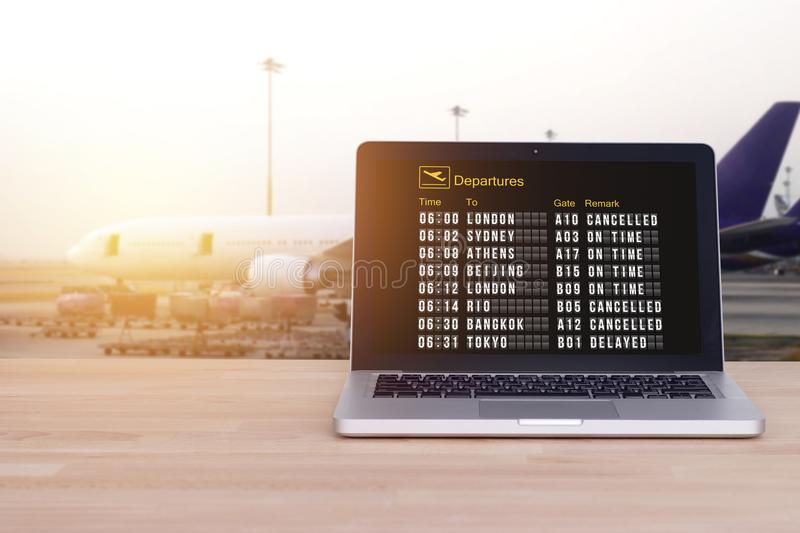 Technology for comfortable travel, tourist, traveler concept. Flight status on notebook , laptop with airport and blur airplane background , film effect royalty free stock images