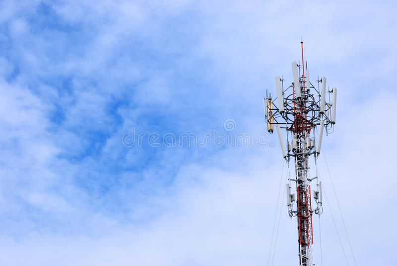Technology of communication. Cloudy day and the telecommunication pole for background royalty free stock photography