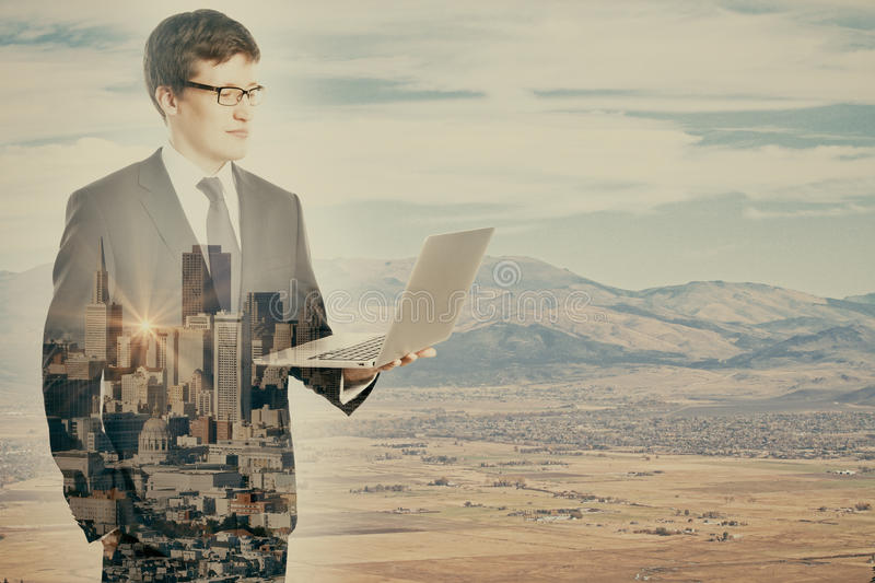 Technology concept. Businessman using computer on city background. Technology concept. Double exposure stock illustration