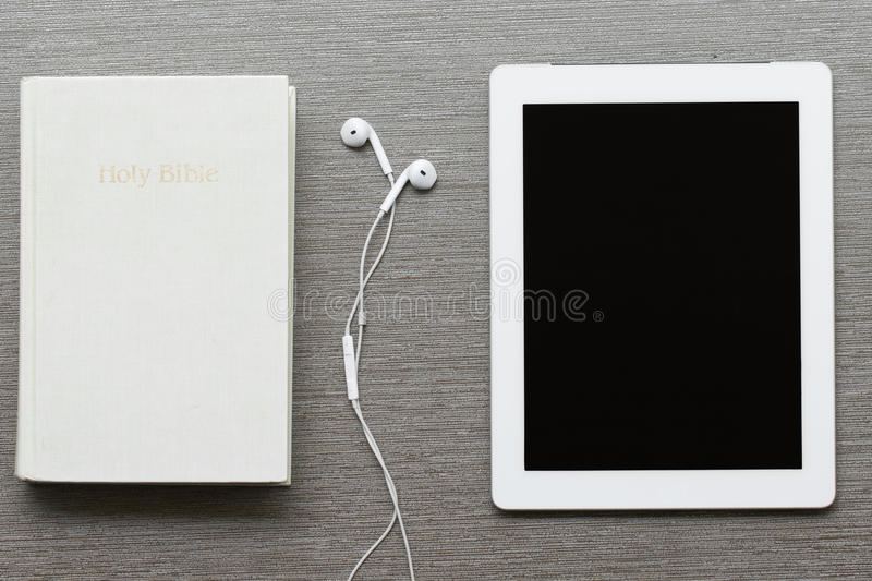 Technology and electronics. Digital tablet, mobile phone and earphones stock photos