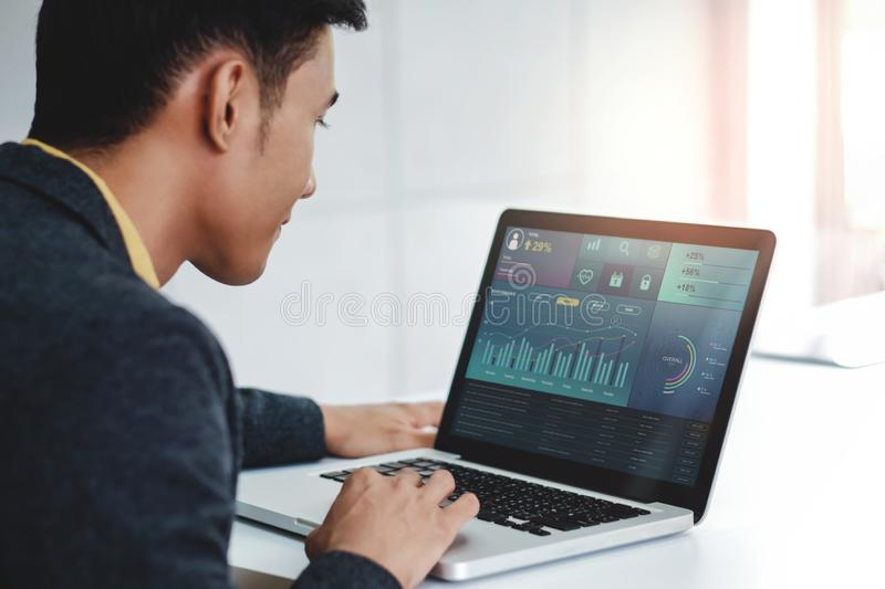 Technology in Finance and Business Marketing Concept. Graphs and Charts show on Computer`s Screen. Modern Businessman seeing royalty free stock image