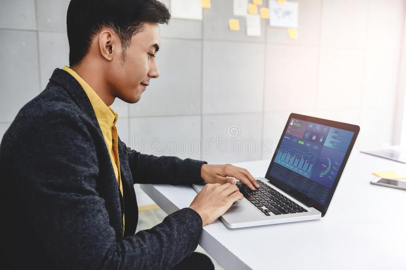 Technology in Finance and Business Marketing Concept. Graphs and Charts show on Computer`s Screen. Modern Businessman seeing royalty free stock photos