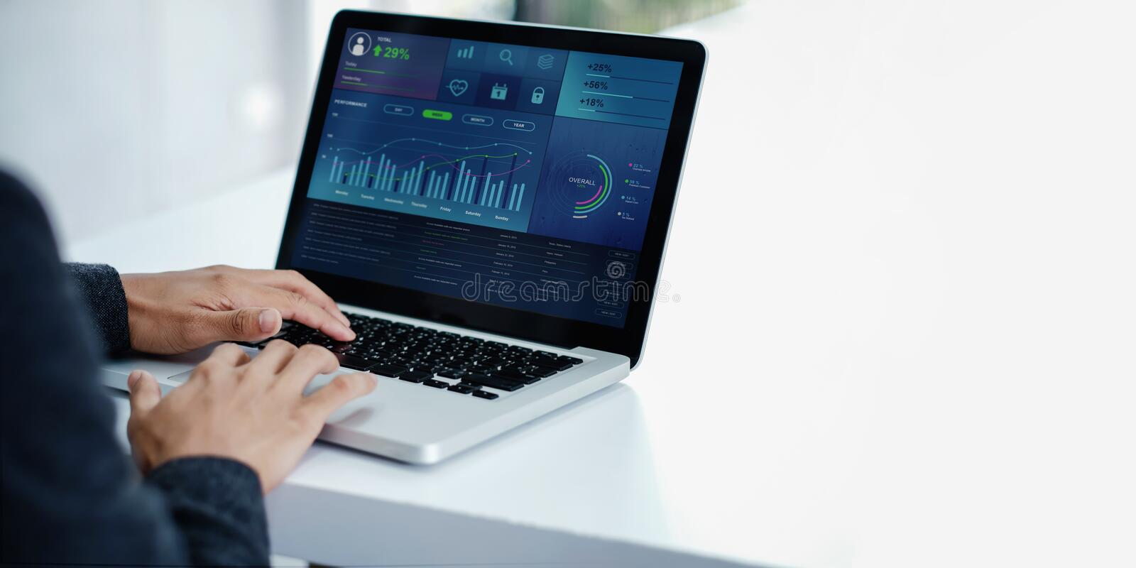 Technology in Finance and Business Marketing Concept. Graphs and Charts show on Computer`s Screen. Modern Businessman seeing Statistical Data on Laptop in royalty free stock images
