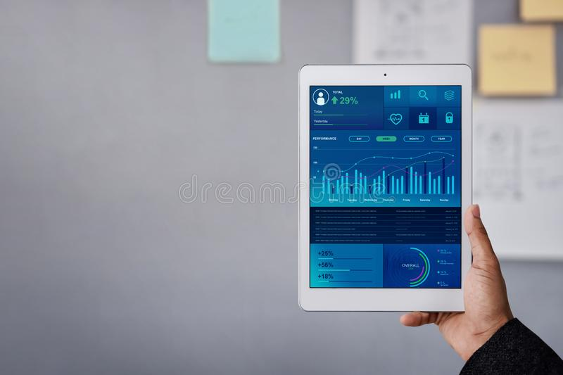 Technology in Finance and Business Marketing Concept. Graphs and Charts show on Touch Pad`s Screen. Modern Businessman seeing stock images