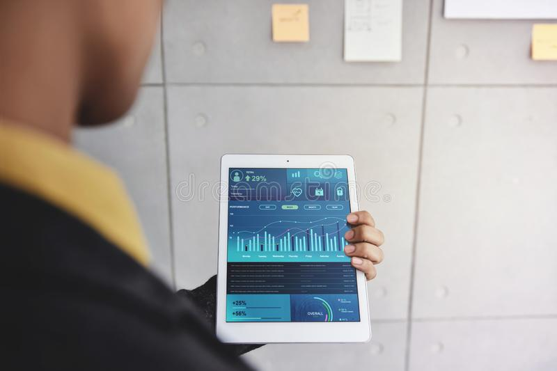 Technology in Finance and Business Marketing Concept. Graphs and Charts show on Touch Pad`s Screen stock photo