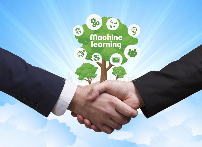 Technology, the Internet, business and network concept. Business. Men shake hands: Machine learning royalty free stock photo