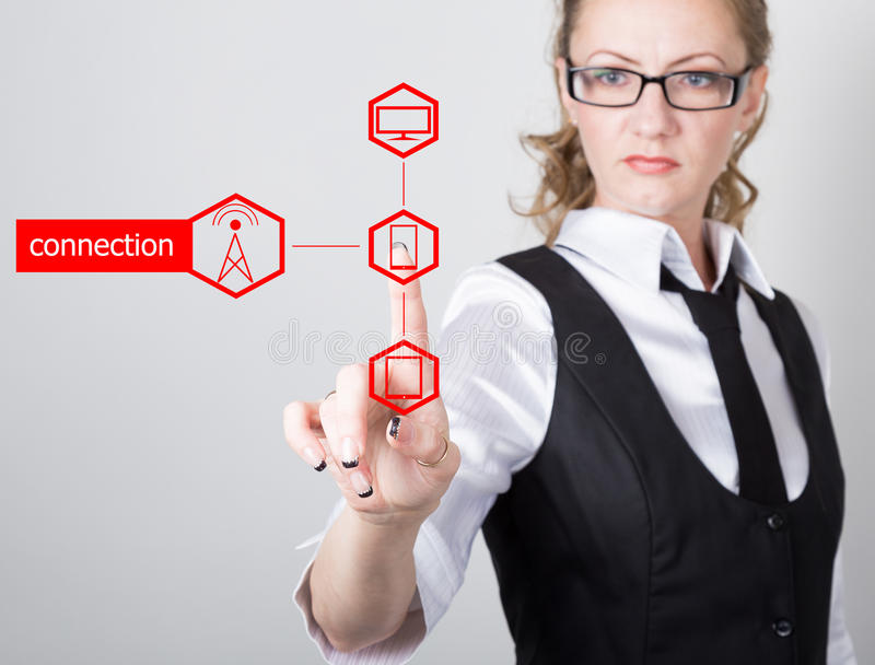 Technology, internet and networking concept. beautiful woman in a black business shirt. woman presses connection button. On virtual screens stock image