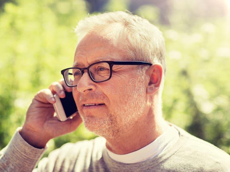 Happy senior man calling on smartphone in city royalty free stock photo