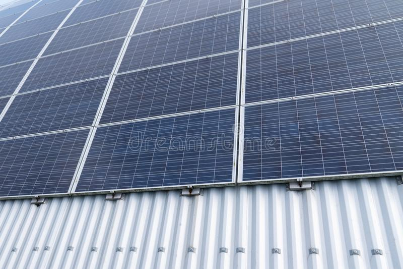 Technology solar panels row for alternative ecology electricity energy royalty free stock photo