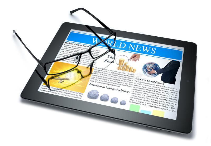 Technology Tablet Online News. An ipad tablet computer and glasses with the world news on the screen