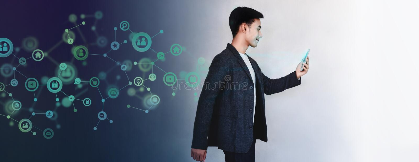 Technology to Communicate in Daily Life Concept. Young Motivation Businessman Using Smart Phone while Walk. Lifestyle of Modern stock photography