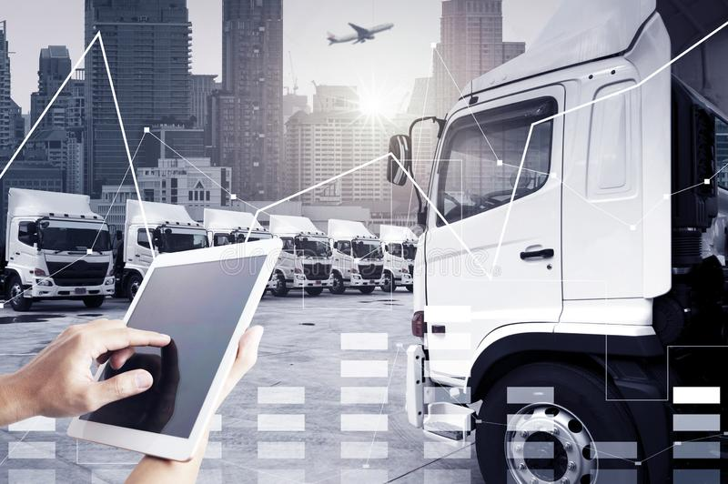 Technology transportation by people is using tablet to control trucking transportation mode. For logistics royalty free stock images