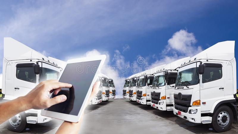 Technology transportation by people is using tablet to control trucking transportation mode. For logistics royalty free stock image