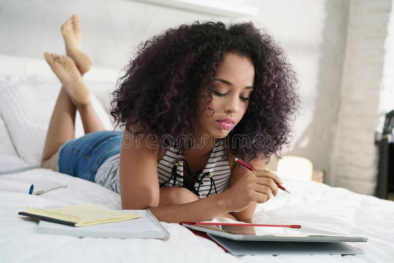 Technology For Young Hispanic Woman Studying With Laptop Computer royalty free stock photo