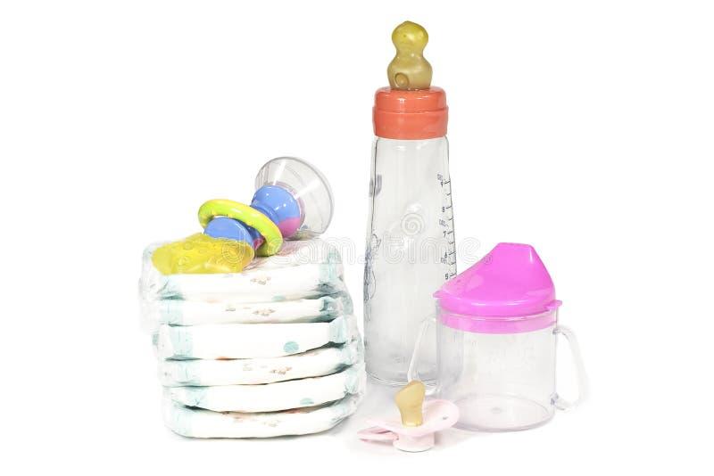 Tecidos, Pacifier e brinquedo fotografia de stock