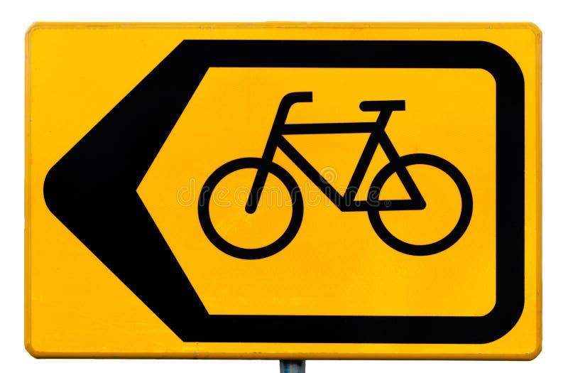 Tecken för cyklister som indikerar en trafikskenmanöver arkivfoto