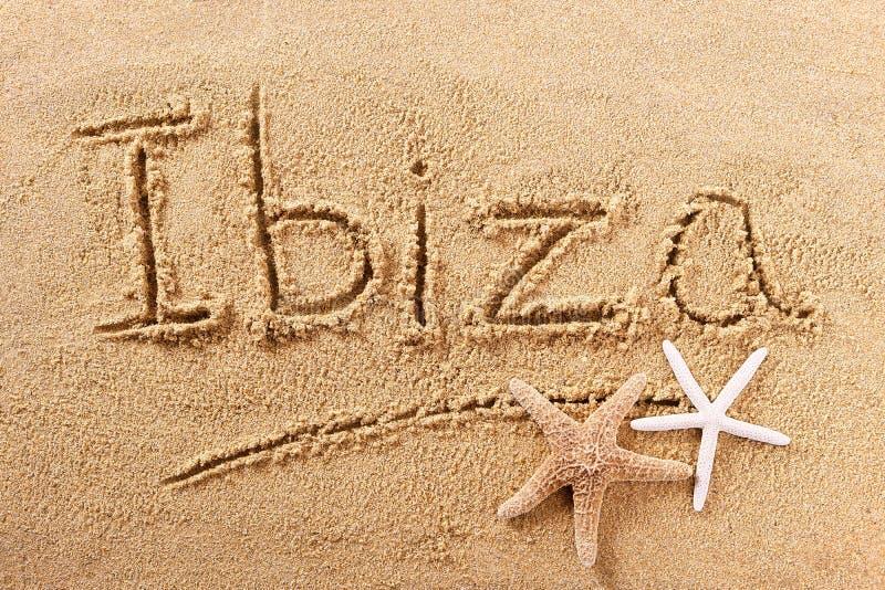 Tecken för Ibiza Spanien strandsand arkivfoton