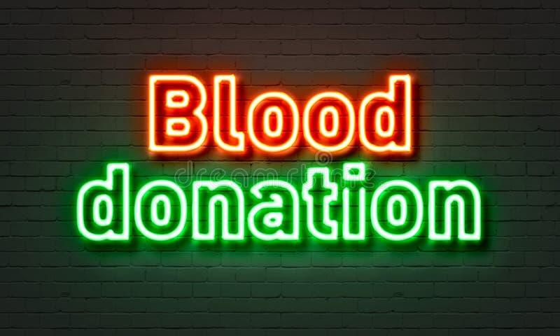 Tecken för neon för bloddonation på bakgrund för tegelstenvägg royaltyfri bild