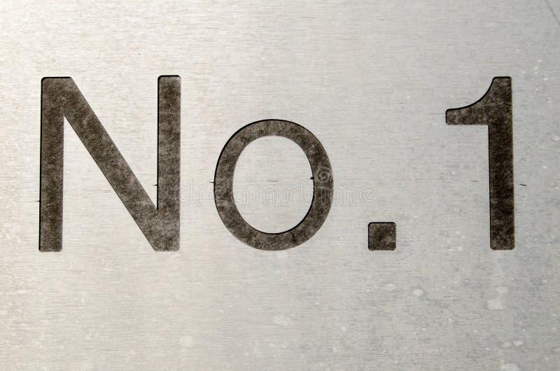Tecken för nummer ett arkivfoton