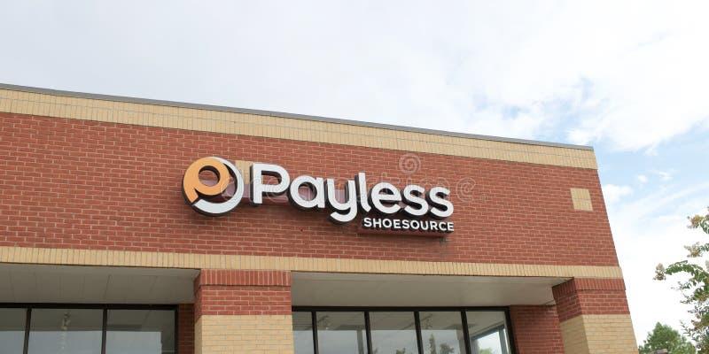 Tecken för Payless skokälla royaltyfri bild