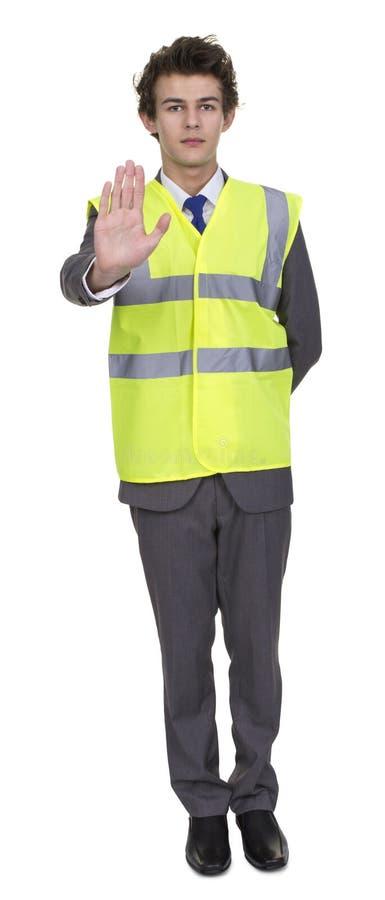 Tecken för stopp för affärsmanWearing Security Jacket visning royaltyfria foton