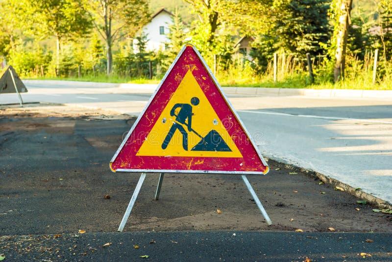 Tecken för vägarbeten arkivfoto