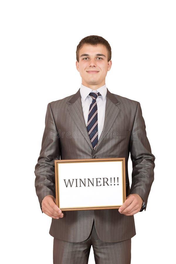 Tecken för vinnare för lycklig ung affärsperson hållande fotografering för bildbyråer