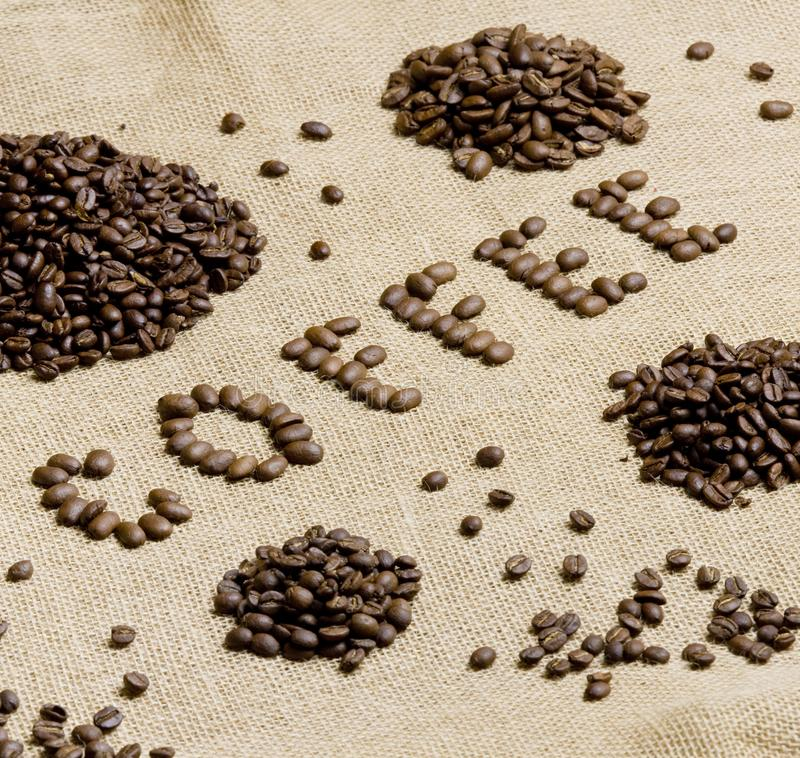 tecken som göras av kaffebönor royaltyfri foto