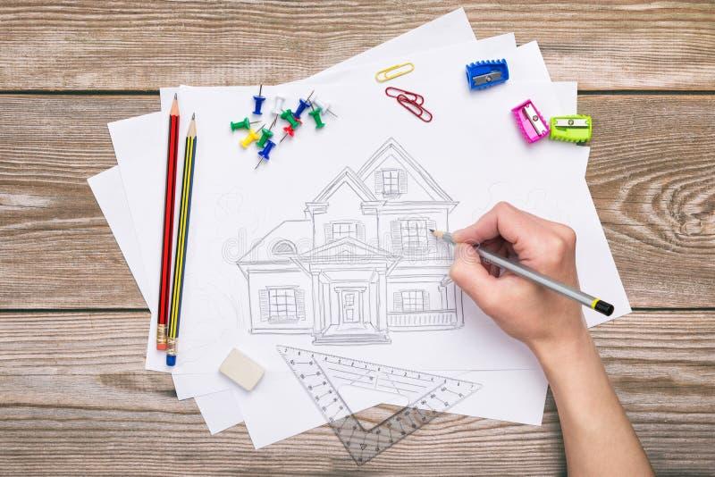 tecknande tecknat avläst handhus royaltyfri bild