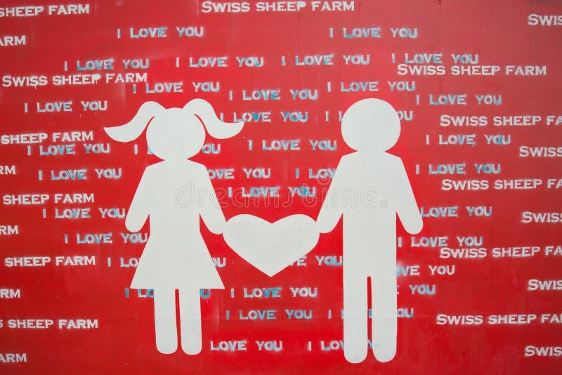Tecknet av förälskelse på de schweiziska fåren brukar var är den största fårlantgården och gyckel parkerar stil Cha-är in royaltyfria bilder