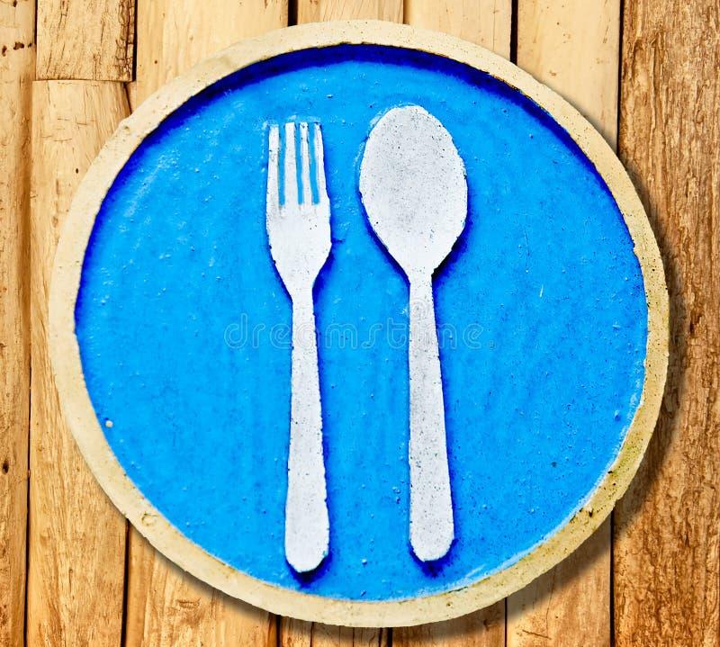 Tecknet av gaffeln och skeden arkivfoto