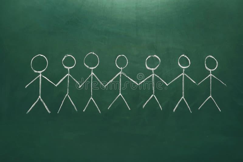 Teckning av folk som tillsammans rymmer händer arkivbild