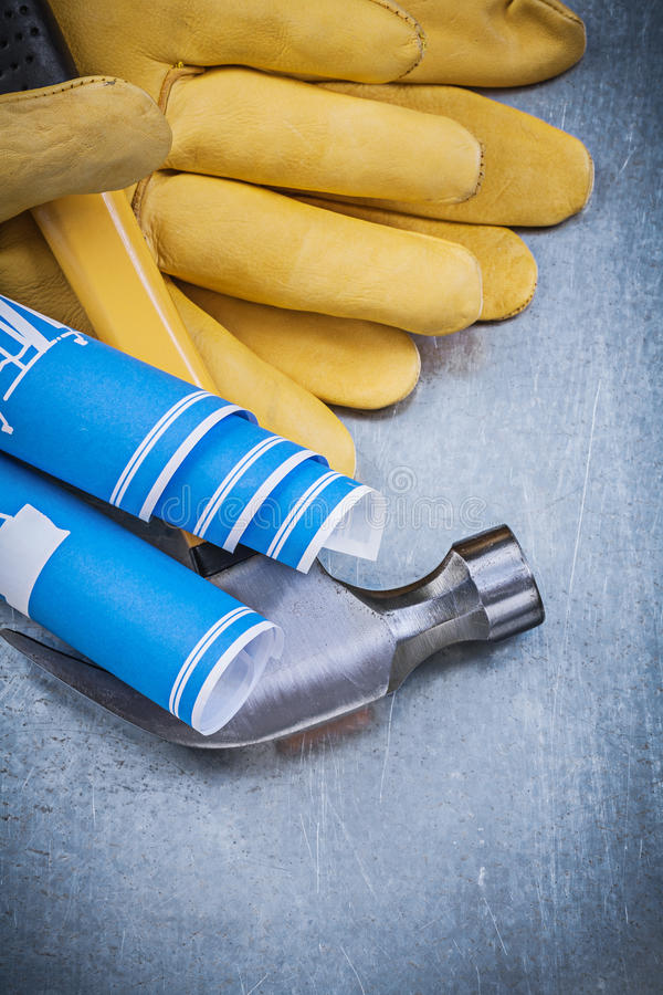 Teckningar för teknik för blått för skyddande handskar klöser hoprullade hamme arkivfoton