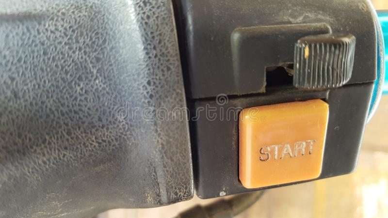Tecla de partida vieja del motor de la motocicleta fotografía de archivo