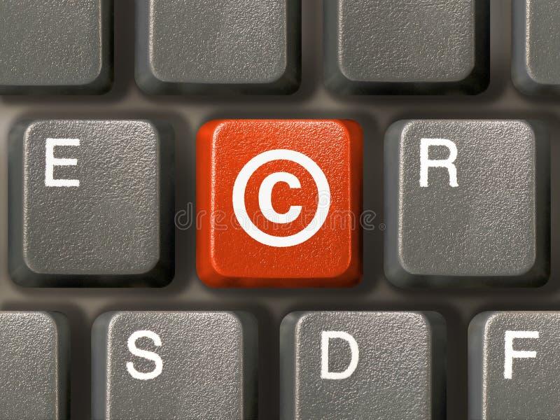 Teclado, clave con los derechos reservados fotos de archivo
