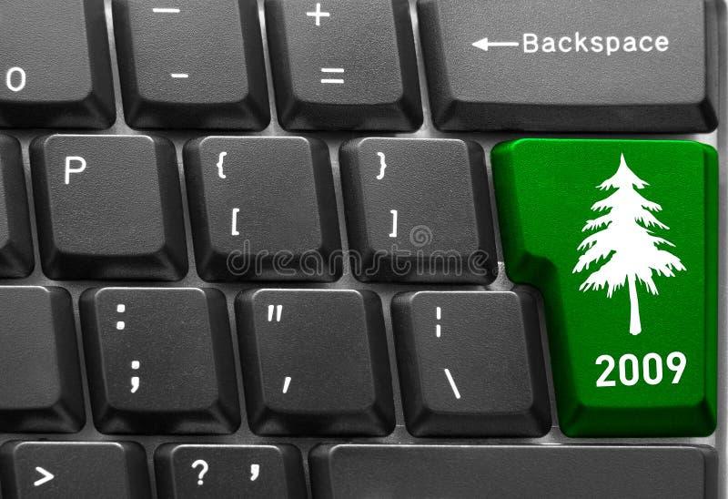Teclado com chave da árvore de Natal fotos de stock royalty free
