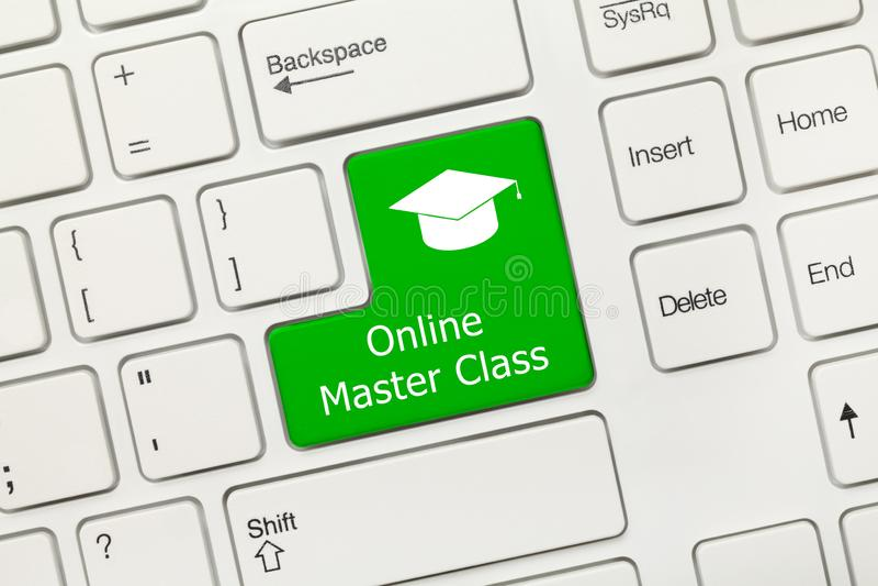 Teclado conceptual blanco - llave verde de la clase en línea del amo fotos de archivo libres de regalías