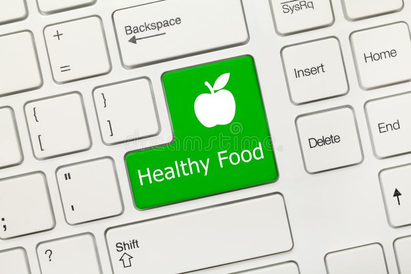 Teclado conceptual branco - chave saudável do verde do alimento com maçã s fotografia de stock royalty free