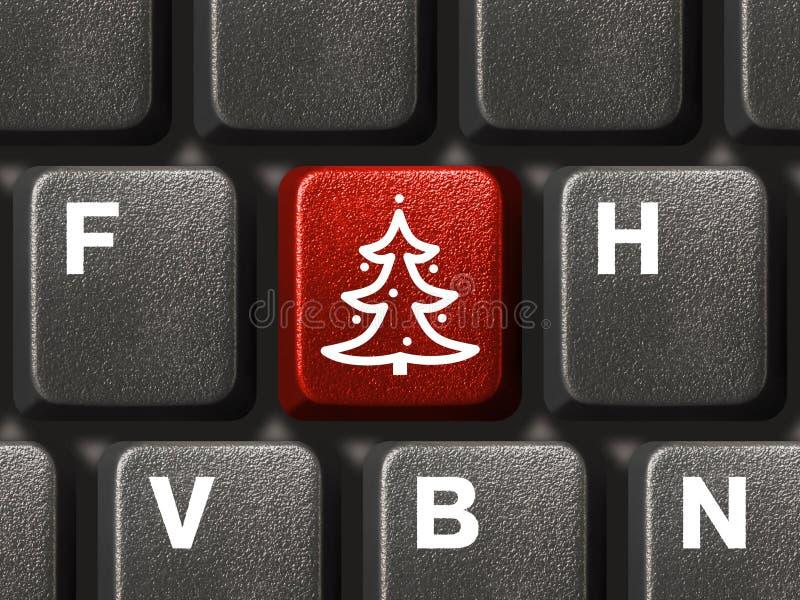 Teclado de computador com chave da árvore de Natal fotos de stock