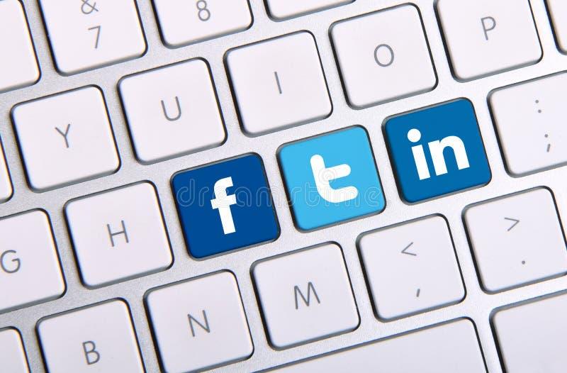 Teclado de Facebook Twitter e de Linkedin fotografia de stock