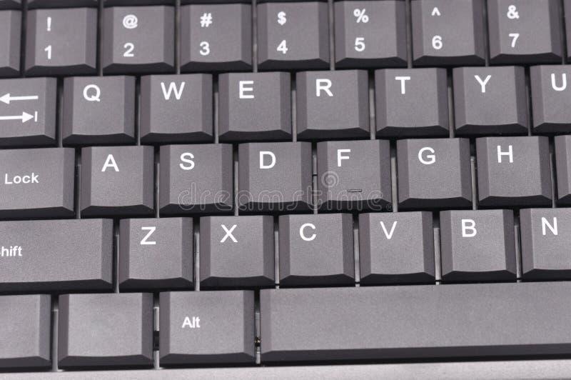 Teclado de ordenador gris oscuro foto de archivo
