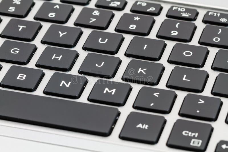 Teclado del ordenador portátil con llaves negras primer fotografía de archivo