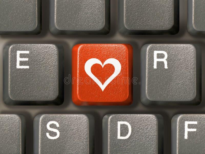 Teclado (primer), clave rojo con el corazón fotografía de archivo libre de regalías