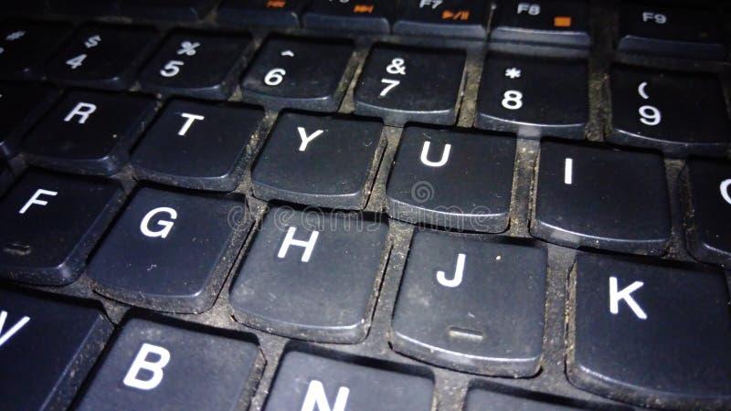 teclado que está sujo com poeira imagens de stock