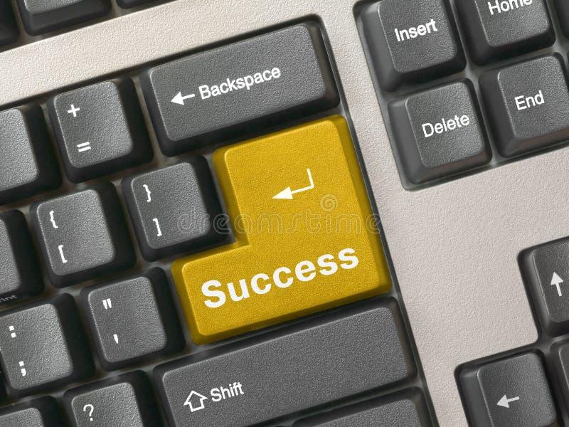 Teclado - sucesso da chave dourada imagens de stock