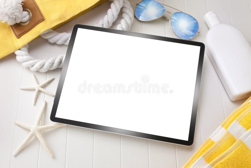 Tecnología de las vacaciones del viaje de la tableta foto de archivo