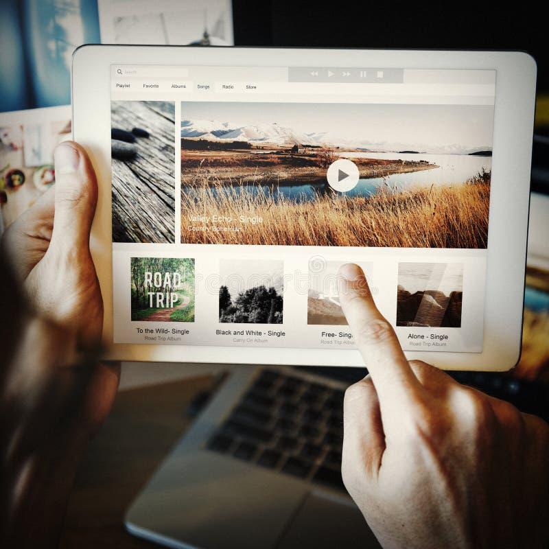 Tecnología Tab Choosing Music Playlist Concept imagenes de archivo