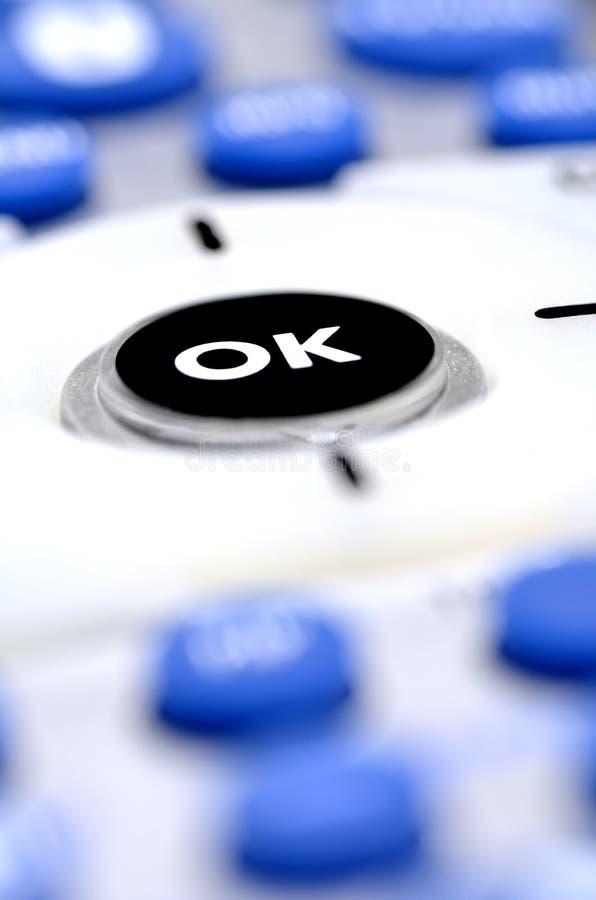 Tecnologia de controle remoto do botão aprovado foto de stock