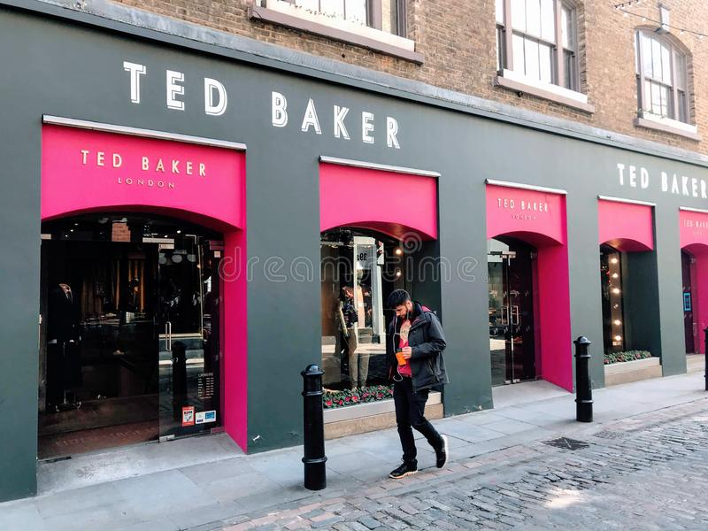 TED BAKER store, London. Ted Baker plc is a British premium clothing retail company. It is listed on the London Stock Exchange and is a constituent of the FTSE stock image