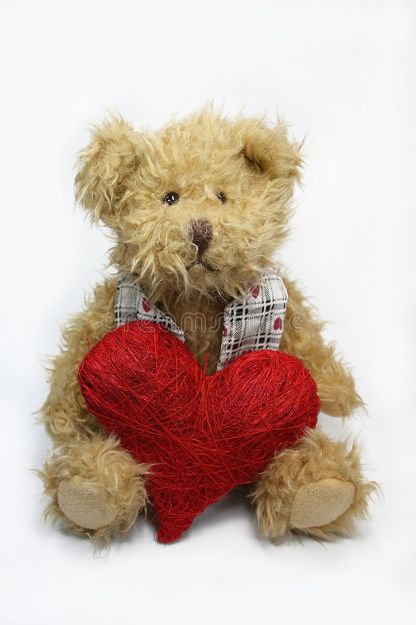 Teddy bear. With red heart on the white background royalty free stock photography